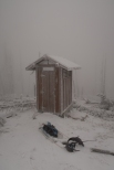 The outhouse was open, clean, stocked with t.p., and even had sled parking!
